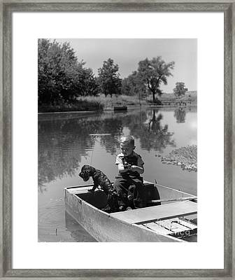 Boy With Dog In Fishing Boat Framed Print