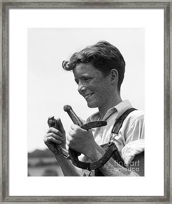 Boy With Horseshoes, 1930s Framed Print by H. Armstrong Roberts/ClassicStock