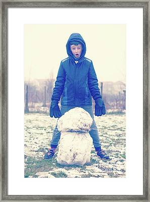 Boy With Snowman Framed Print by Tom Gowanlock