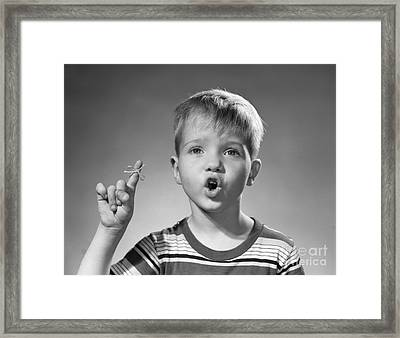 Boy With String Around Finger, C.1950s Framed Print by Debrocke/ClassicStock