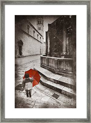 Boy With Umbrella Framed Print by Rod McLean