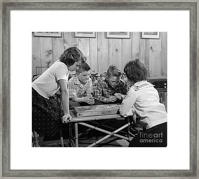 Boys And Girls Playing Board Game Framed Print by H. Armstrong Roberts/ClassicStock