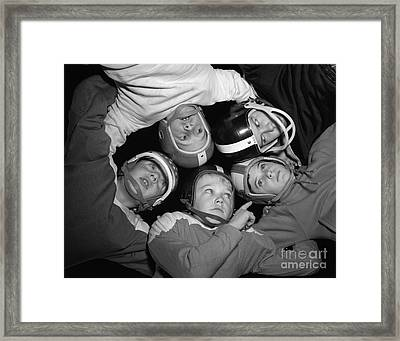 Boys In Football Huddle, C.1960s Framed Print by D. Corson/ClassicStock