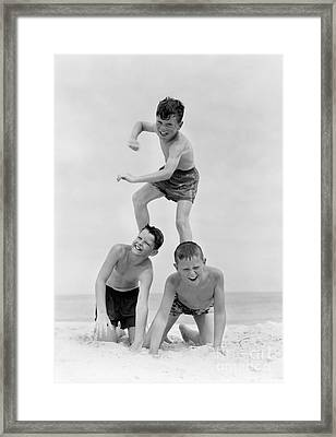 Boys In Pyramid Formation At Beach Framed Print by H. Armstrong Roberts/ClassicStock