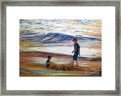 Boys Playing At The Beach Framed Print