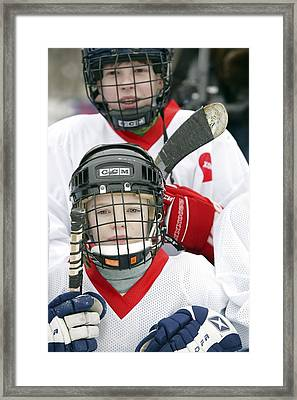 Boys Playing Ice Hockey Framed Print by Ria Novosti