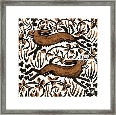 Bramble Hares Framed Print by Nat Morley