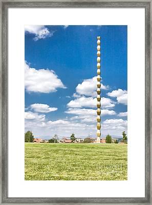 Brancusi's Infinite Column Framed Print by Gabriela Insuratelu