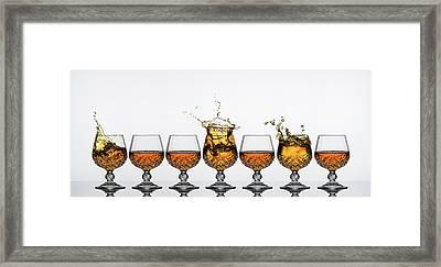 Brandy Glass Splash Framed Print