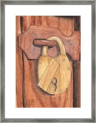 Brass Lock On Wooden Door Framed Print by Ken Powers