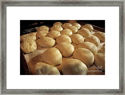 Bread Dough Resting In Preparation Of Being Cooked In A Bakery Framed Print by Sami Sarkis