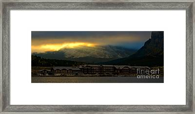 Breaking Storm Clouds Over Many Glacier Framed Print by Adam Jewell