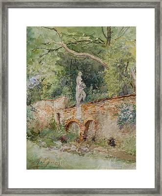 Brick Bridge With A Stone Figure Framed Print by Marie Egner