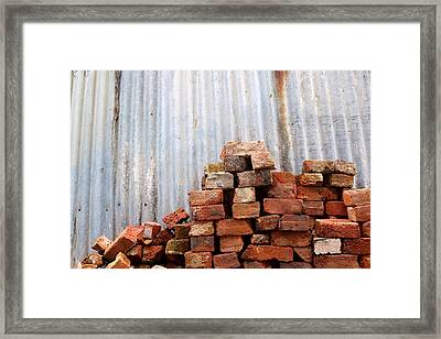 Framed Print featuring the photograph Brick Piled by Stephen Mitchell