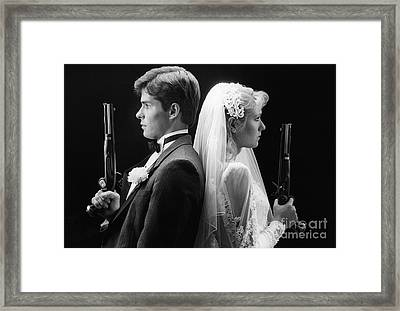 Bride And Groom With Dueling Pistols Framed Print