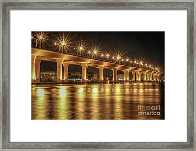 Bridge And Golden Water Framed Print