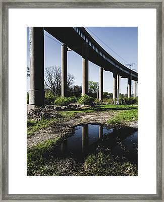 Bridge And Puddle Framed Print by Dylan Murphy