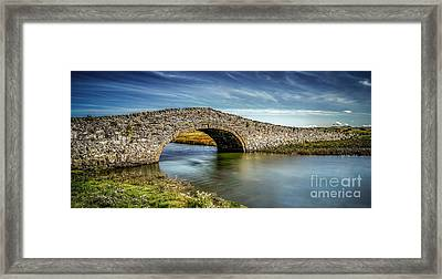 Bridge At Aberffraw Framed Print by Adrian Evans