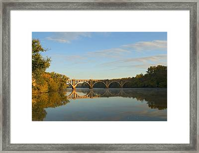 Bridge At Sunrise Framed Print by John Magor