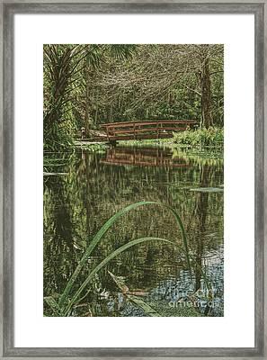 Bridge Over A Pond Framed Print by Marvin Reinhart