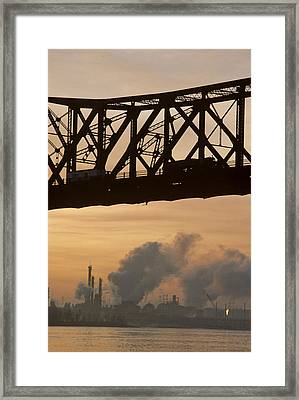 Bridge, River, And Skyline Full Of Air Framed Print by Kenneth Garrett