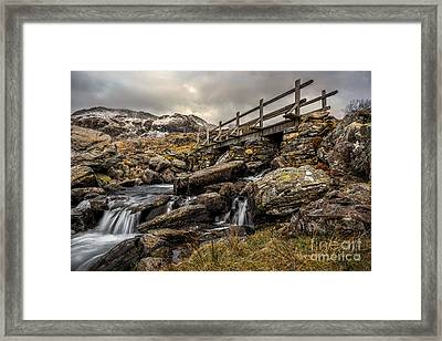 Bridge To Moutains Framed Print by Adrian Evans