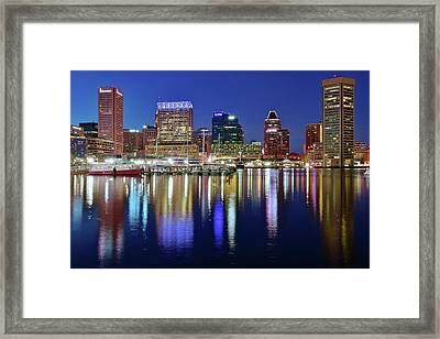 Framed Print featuring the photograph Bright Blue Baltimore Night by Frozen in Time Fine Art Photography