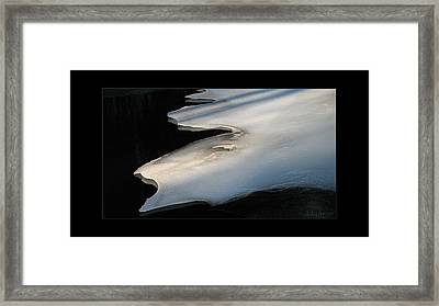 Bright Ice Black Water Framed Print by Doug Bratten