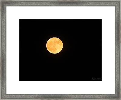 Bright Orange Moon Framed Print