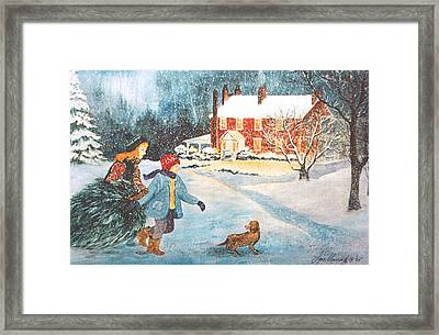 Bringing In The Tree Framed Print by Lois Mountz