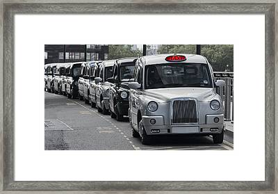 British Taxi Stand Framed Print by Daniel Hagerman