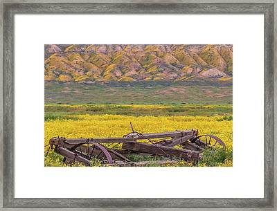Framed Print featuring the photograph Broken Wagon In A Field Of Flowers by Marc Crumpler
