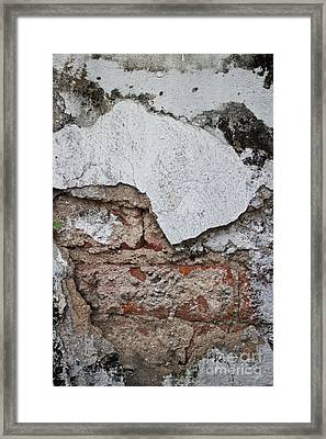 Broken White Stucco Wall With Weathered Brick Texture Framed Print