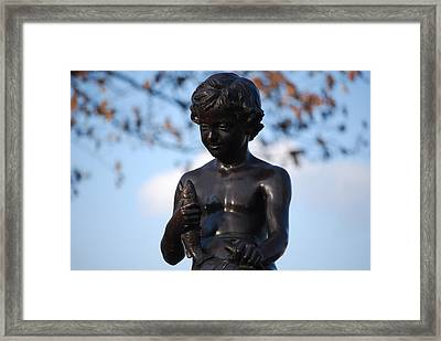 Bronze Boy Fisherman Framed Print by Peter  McIntosh
