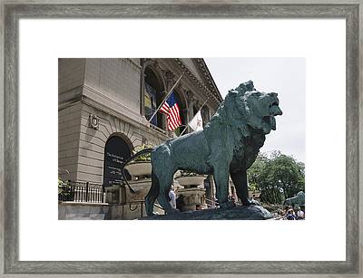 Bronze Lions Stand Guard Over The Art Framed Print by Paul Damien