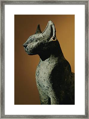 Bronze Statue Of Cat Representing Framed Print by Kenneth Garrett