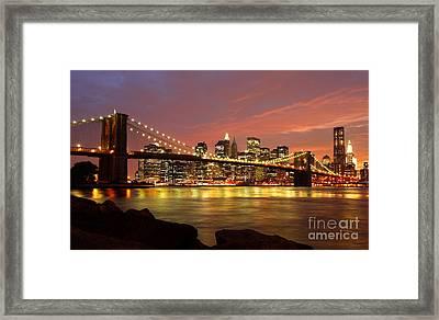 Brooklyn Bridge At Night Framed Print by Holger Ostwald