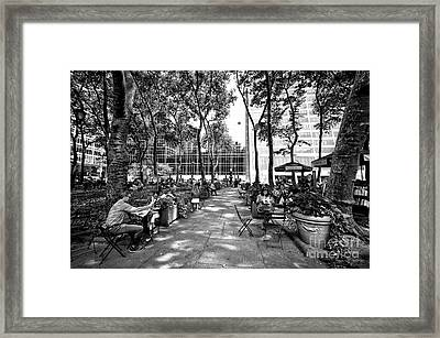 Bryant Park Reading Framed Print by John Rizzuto