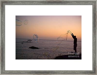 Bubbles On The Beach Framed Print by Jim and Emily Bush