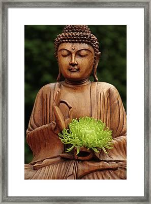 Buddha Statue Holding Flower Framed Print by Christine Amstutz