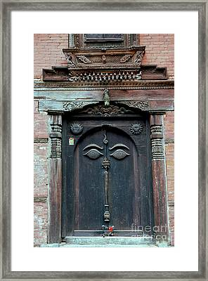 Buddha's Eyes On Nepalese Wooden Door Framed Print