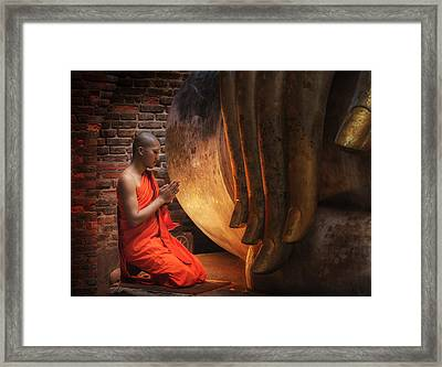 Buddhism Monk Sit In The Temple  Framed Print by Anek Suwannaphoom