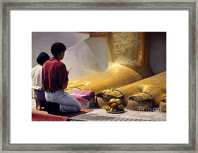 Framed Print featuring the photograph Buddhist Thai People Praying by Heiko Koehrer-Wagner