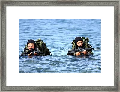 Buds Students Wade Ashore During An Framed Print by Stocktrek Images