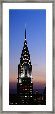 Building Lit Up At Twilight, Chrysler Framed Print by Panoramic Images