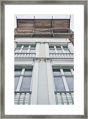 Building Repairs Framed Print by Tom Gowanlock
