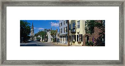 Buildings Along A Street With A Church Framed Print by Panoramic Images