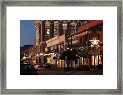 Buildings Lit Up At Dusk, Palafox Framed Print