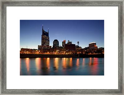 Buildings Lit Up At Dusk Framed Print by Panoramic Images