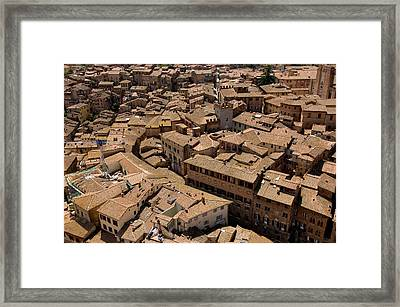 Buildings Seem To Run Into Each Other Framed Print by Joel Sartore